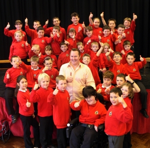 Aled with the children of Llanbrynmair School
